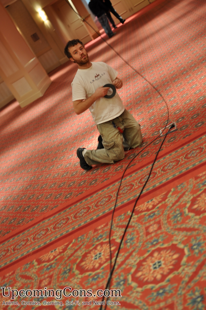 Tech guy setting up cables.